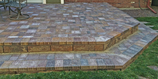 Angular paver patio in a Colorado backyard.