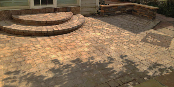 Backyards Plus paver patio with rounded steps.