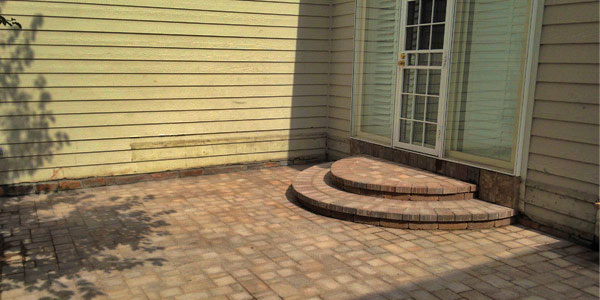 Half circle paver steps by Backyards Plus.