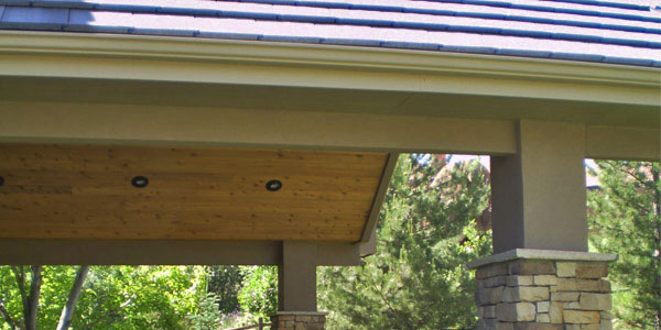 Custom roof for outdoor living area by Backyards Plus.