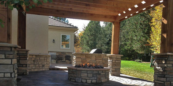 Tall shade structure built over a gas fire pit.