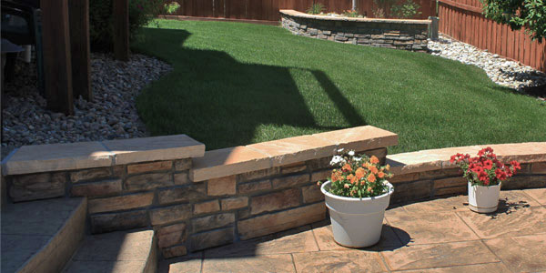 Backyard seating wall along a patio by Backyards Plus near Denver, CO.