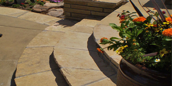 Pie shaped stone steps installed by Backyards Plus.