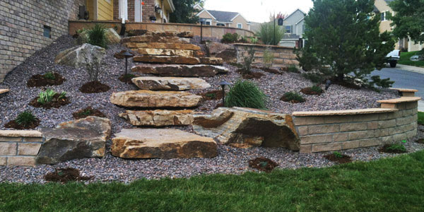 Large stone steps installed by Backyards Plus.