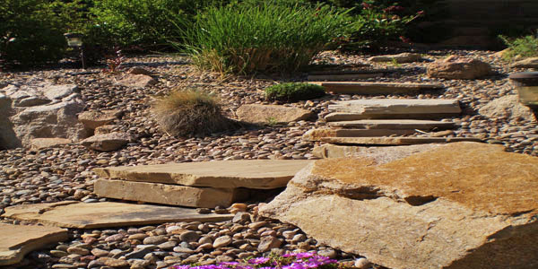 Natural looking stone steps in a Colorado landscape project.