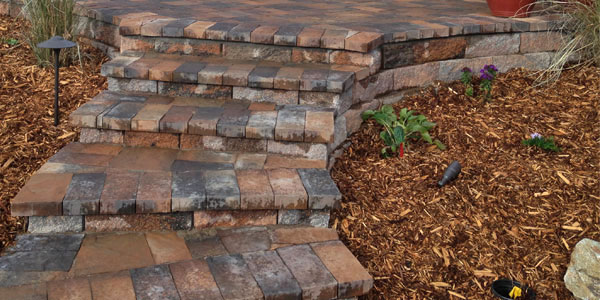 Curved stone steps by Backyards Plus.