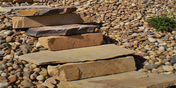 Close up of custom stone steps installed by Backyards Plus.