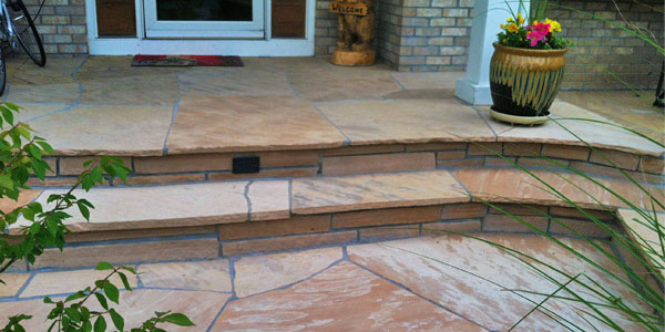 Front patio flagstone steps by Backyards Plus.