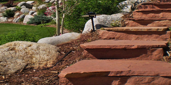 Stone stairs in a Denver landscape project.