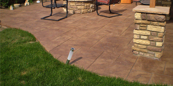 rounded edge stamped concrete patio in Stapleton.