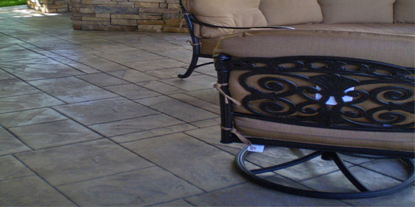 Outdoor living space with stamped concrete floor.