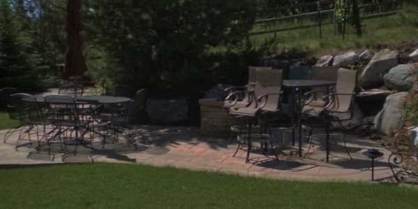 Island stamped concrete patio in a Colorado backyard.