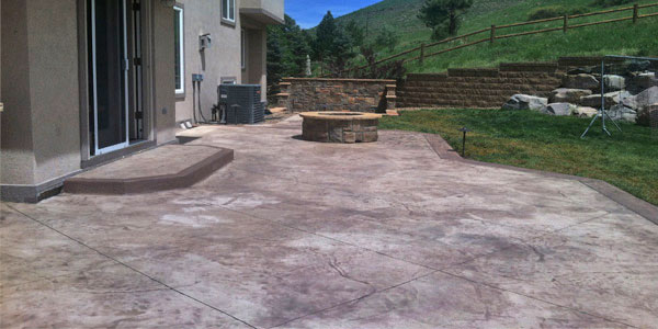 Stamped concrete patio with a natural gas fire pit.